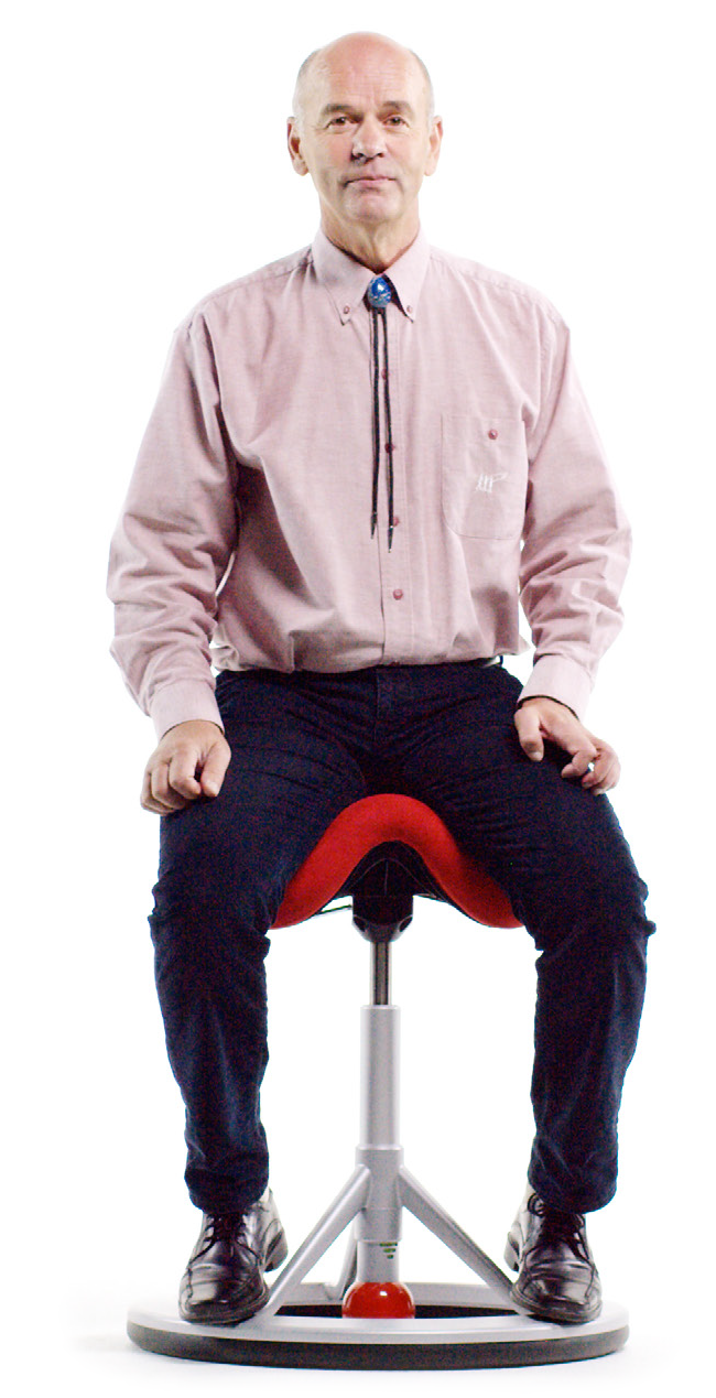 Freddy Johnsen sitting on the ergonomic office chair Back App